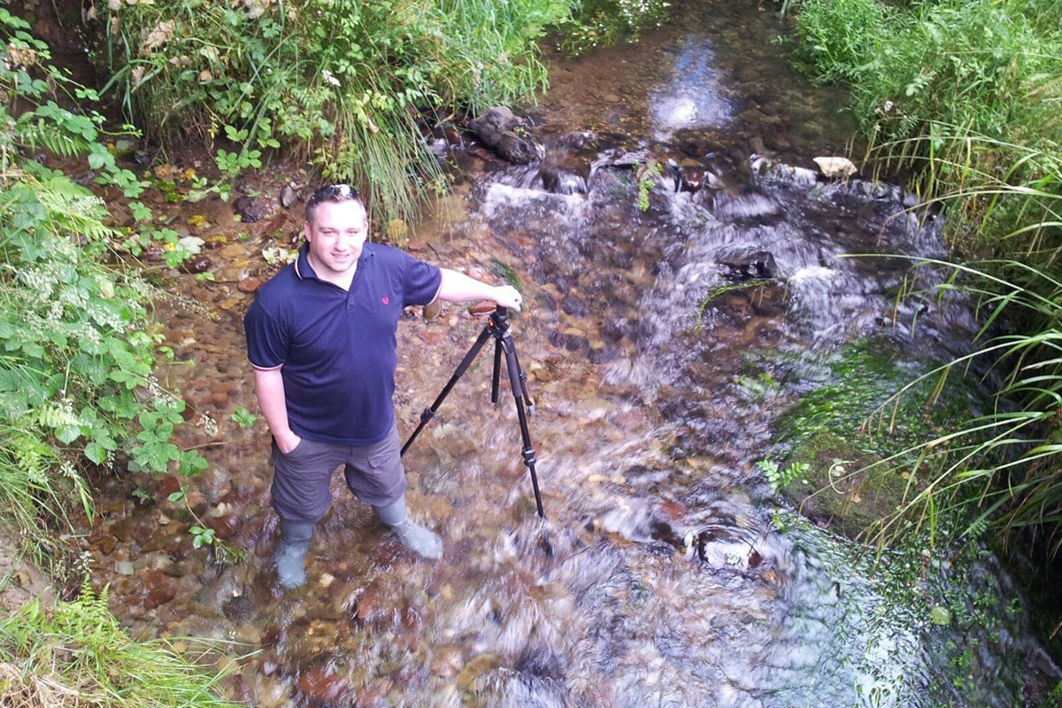 Photographer in the River